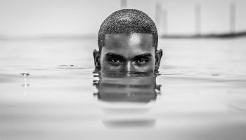 African Man emerging from water